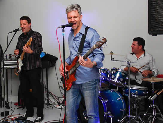 The trio band playing at a 30th birthday party
